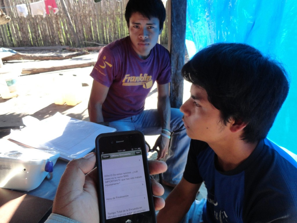 Administering an epidemiologic survey to a Tsimane' participant.